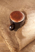 Hot frothy drink cappuccino chocolate dusted, — Stock Photo