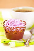 Cupcake with lavender icing top in festive wrap and coffee cup — Stock Photo