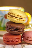 Festive macarons with tea cup, colorful, shallow dof — Stock Photo