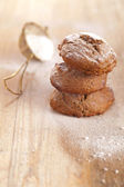 Soft ginger cookies three stacked and dusted on wooden table — Stock Photo