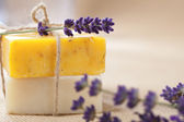 Handmade soap bars with lavender flowers, shallow DOF — Stock Photo
