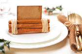 Aromatic christmas place setting place with card, holly twig in — Stock Photo