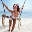 Woman on a beach with swing — Stock Photo #5706603