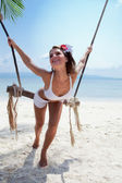Woman on a beach with swing — Stock Photo