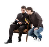 Two men recorded testimony multimeter. — Stock Photo