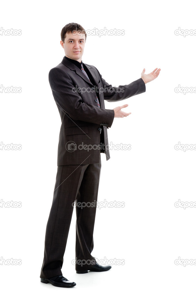 A young man in a suit gestures with his hands, isolated on a white background. — Stock Photo #5652448