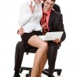 Young man and woman sitting in a chair, looking at laptop. — Stock Photo #5707257