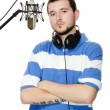Young guy with a beard in the headphones and microphone. — Stock Photo
