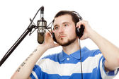 Young guy with a beard, writes a song with headphones and a micr — Stock Photo