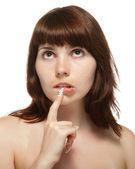 Jonge vrouw raakte zijn vinger aan zijn lippen. — Stockfoto
