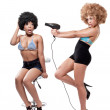 Two young beautiful pinup girls in a hairdresser salon - Stock Photo