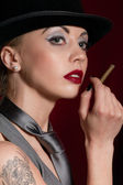 Young woman with a cigar — Stock Photo