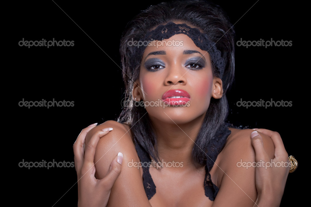 Young beautiful black woman, on black with party lights — Stock Photo #5621387