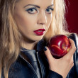 Sensual blond woman with an apple - Stock Photo