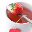 Closeup shot of cup of fruit tea with strawberry as teabag, isol - Stock Photo