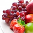 Mixed fruits on a plate - Stock Photo