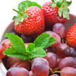 Strawberry, grapes and mint - Stock Photo