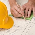 Architect with blueprint — Stock Photo