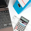 Tax form, part of laptop, calculator, office folder and pen — Stock Photo