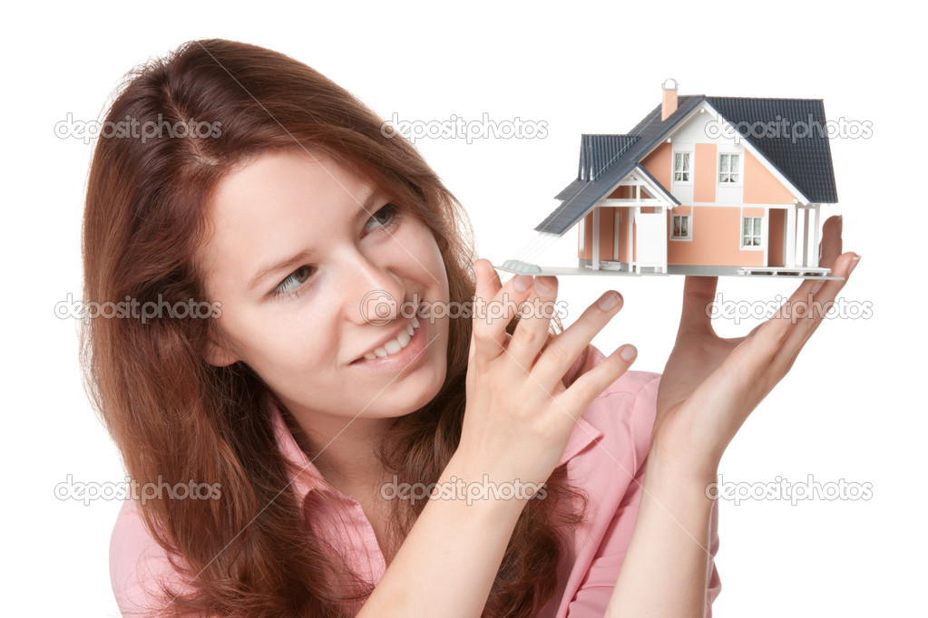 Woman (estate agency client) dream about new house - model of the house — Stock Photo #6110334