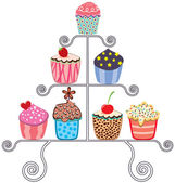 Cupcakes on a stand — Stock Vector