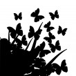 Illustration with silhouettes of butterflies, flowers and grass — Stock Vector