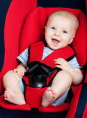 Happy boy in car seat — Stockfoto