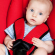 Surprised boy in car seat — Stock Photo