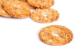 Sesame cakes on white background — Stock Photo
