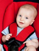 Happy boy in car seat — Stock Photo