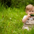 Baby and cucumbers — Stock Photo #6163166