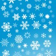 Stock Vector: White snowflakes on blue background