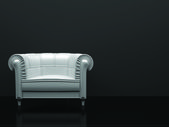 White leather chair in the black room — Stock Photo