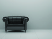 Black leather chair in the white room — Stock Photo