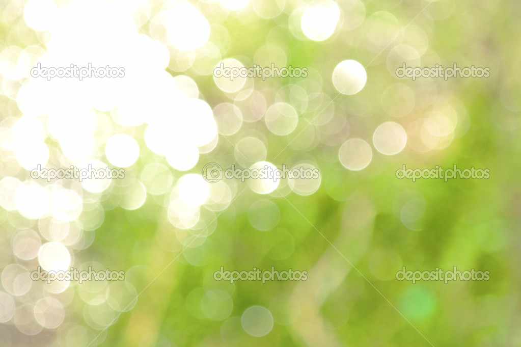 On a green background bright solar reflexions, light game — Stock Photo #5627389