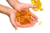 дополнение гель изолированные таблетки капсулы с стороны, макро — Стоковое фото