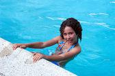 Teen girl on swimming pool — Stock Photo