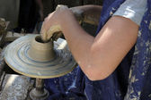 Craftwoman's hands making pottery on a ceramic wheel — Stock Photo