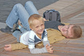 Father and his little son having rest outdoor — Stock Photo
