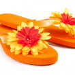 Orange flip-flops with flowers — Stock Photo #6706424