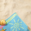 Beach concept with towel and sunglasses — Stock Photo