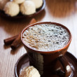 Cup of coffee and white chocolate truffles on table — Stock Photo