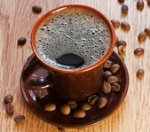 Cup of coffee on a wooden table — Stock Photo