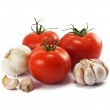 Fresh ripe tomatoes and garlic on white - Stock Photo