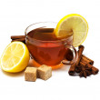 Black tea with lemon and cinnamon — Stock Photo
