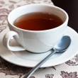 The white cup with black tea — Stock Photo