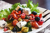 Salad with feta cheese, olives and peppers — Stock Photo
