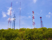 Antenna and cell phone towers — Stock Photo