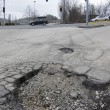 Stock Photo: Pothole in road