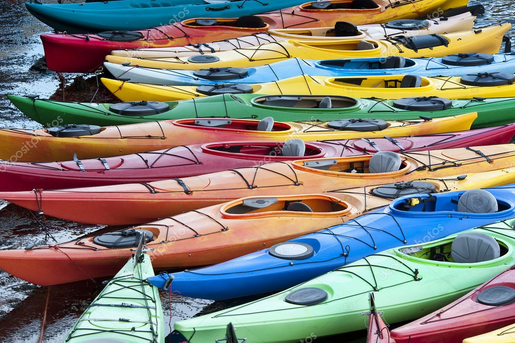 Colorful fiberglass kayaks tethered to a dock as seen from above — Stock Photo #6702580